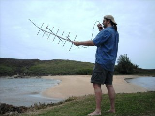 Portable operation can be a lot of fun and doesn't take a big station. Sean Kutzko, KX9X, is using a handheld radio and a small beam antenna to make contacts via an amateur radio satellite while he is on vacation in Puerto Rico. (Photo by Ward Silver, NØAX)